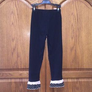 Black knit leggings with ruffles 6X